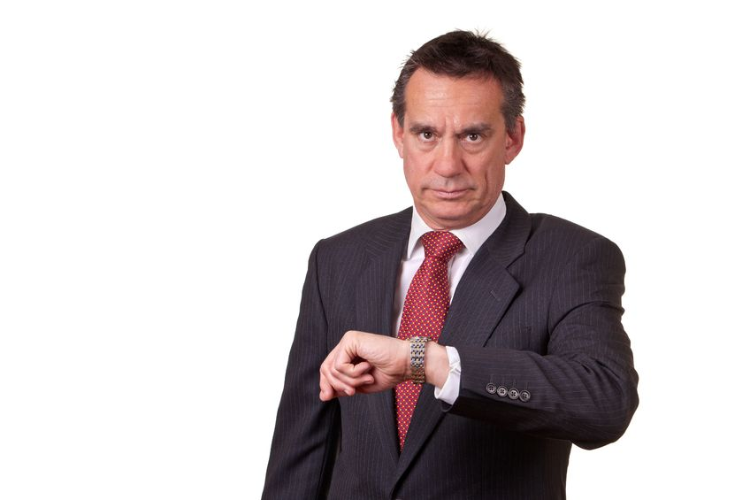 9735424 - frowning angry business man looking at time on watch